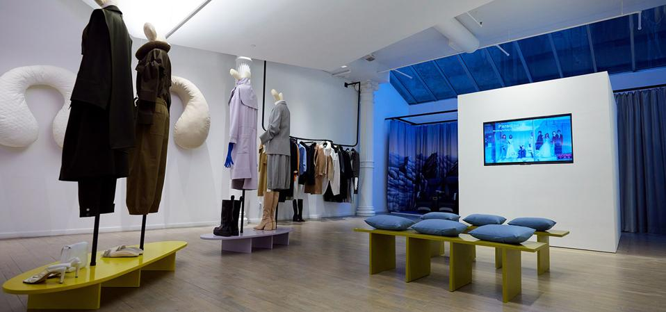 Tibi's Soho store with mannequins dressed the new collection while a collection film plays