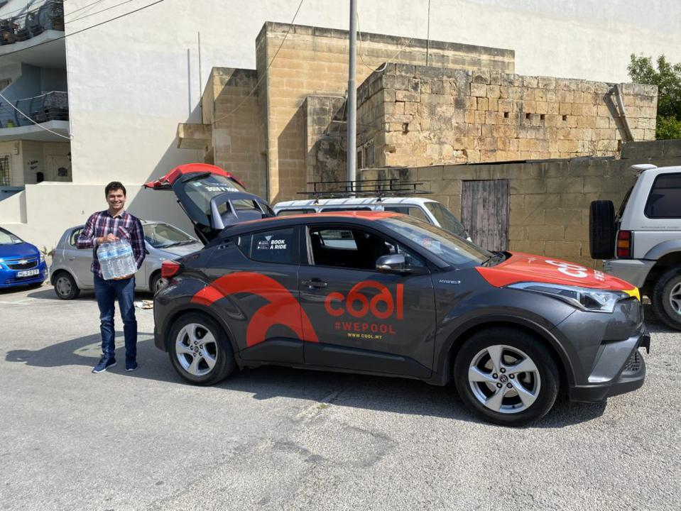 A Cool ridesharing car delivering essential supplies in Malta Coronavirus