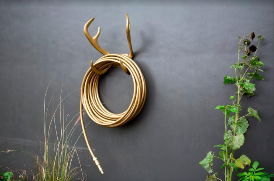 Garden Glory's gold reindeer wall mount, hose and nozzle