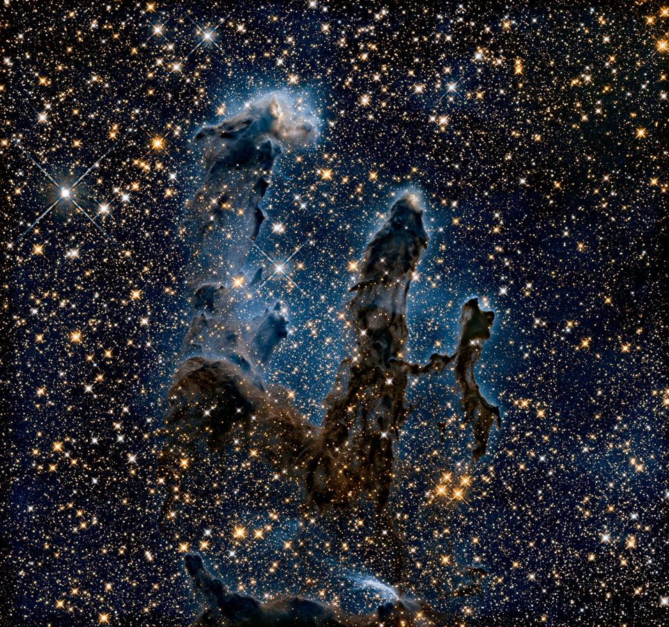 In this Hubble Space Telescope image, researchers revisited one of Hubble's most iconic and popular images: the Eagle Nebula's Pillars of Creation.