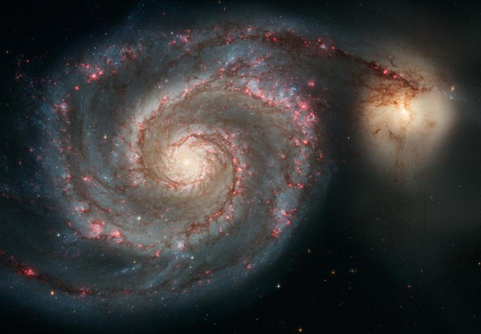 The majestic spiral galaxy M51 appears like a grand spiral staircase sweeping through space.