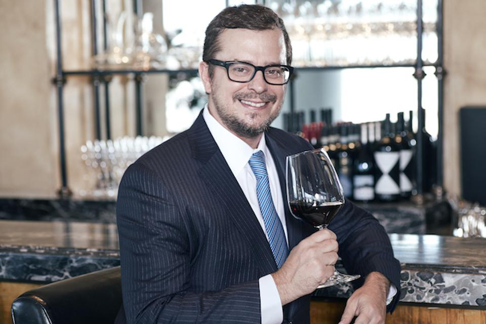 Acker CEO John Kapon with a glass of wine.
