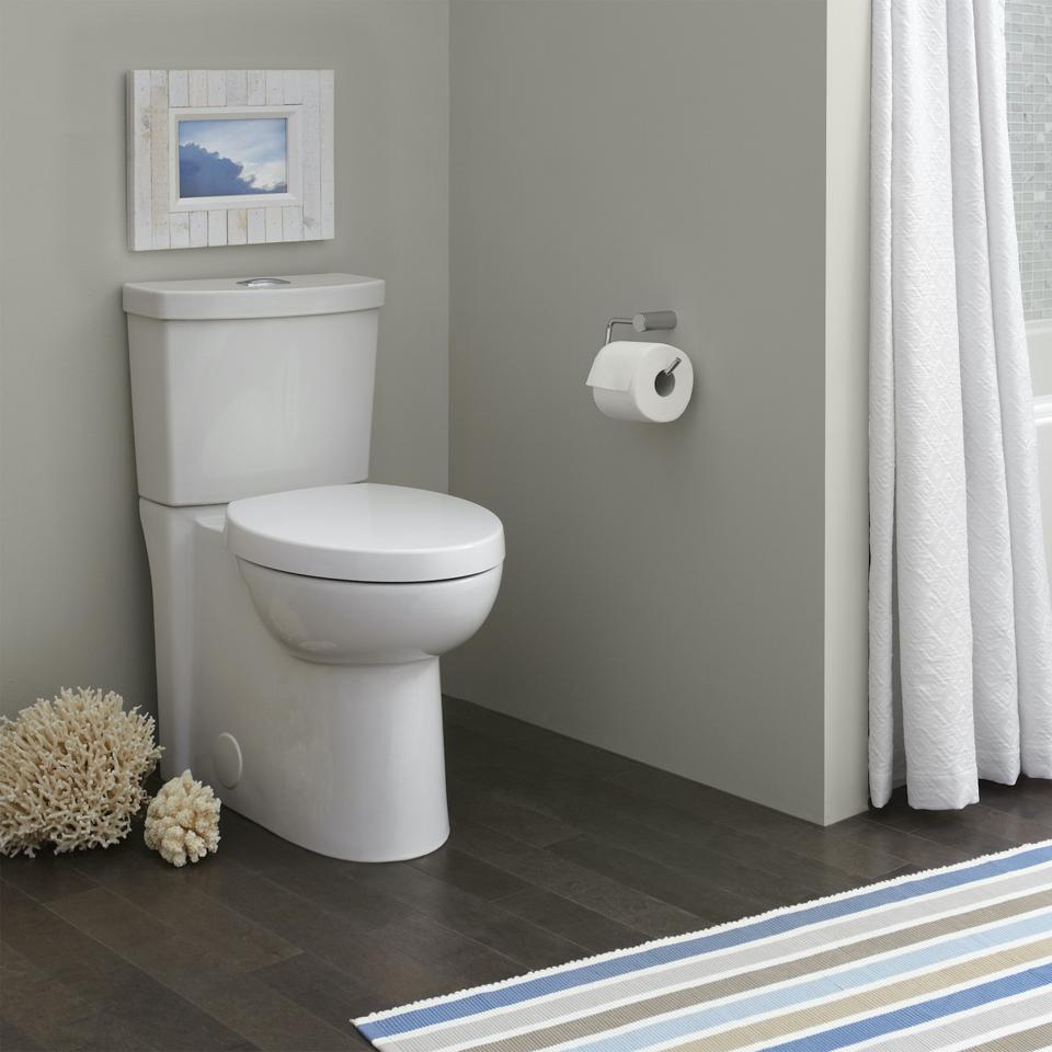 This is American Standard's Studio skirted design dual flush two-piece toilet.