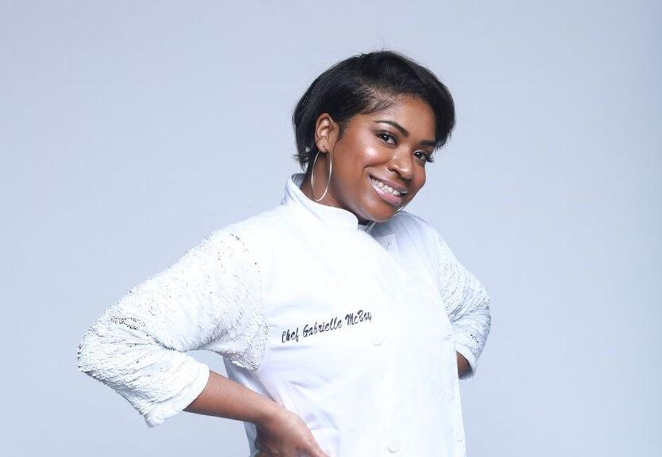 Chef Gabrielle McBay in front of white background.