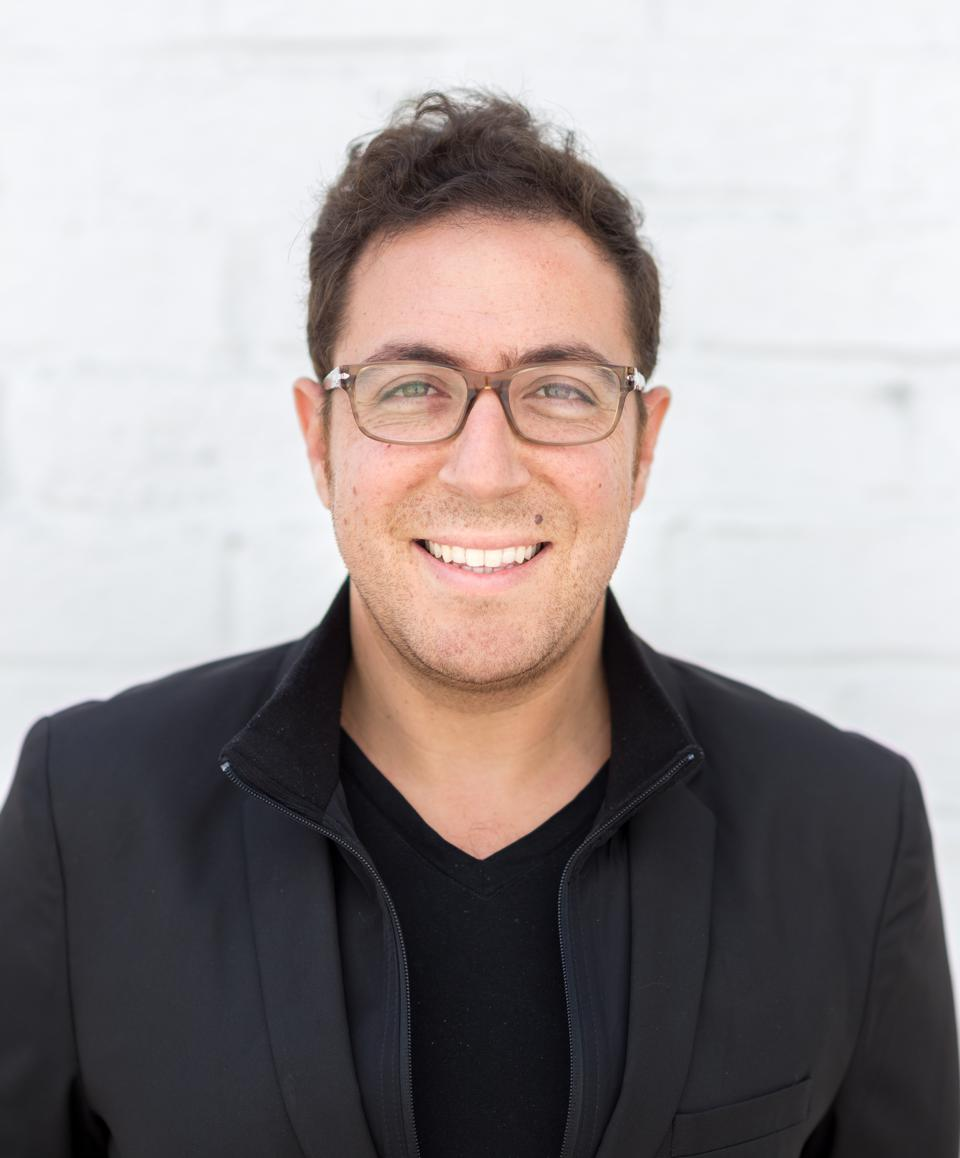 A headshot of Daniel Abas, founder of e-commerce platform Boost.