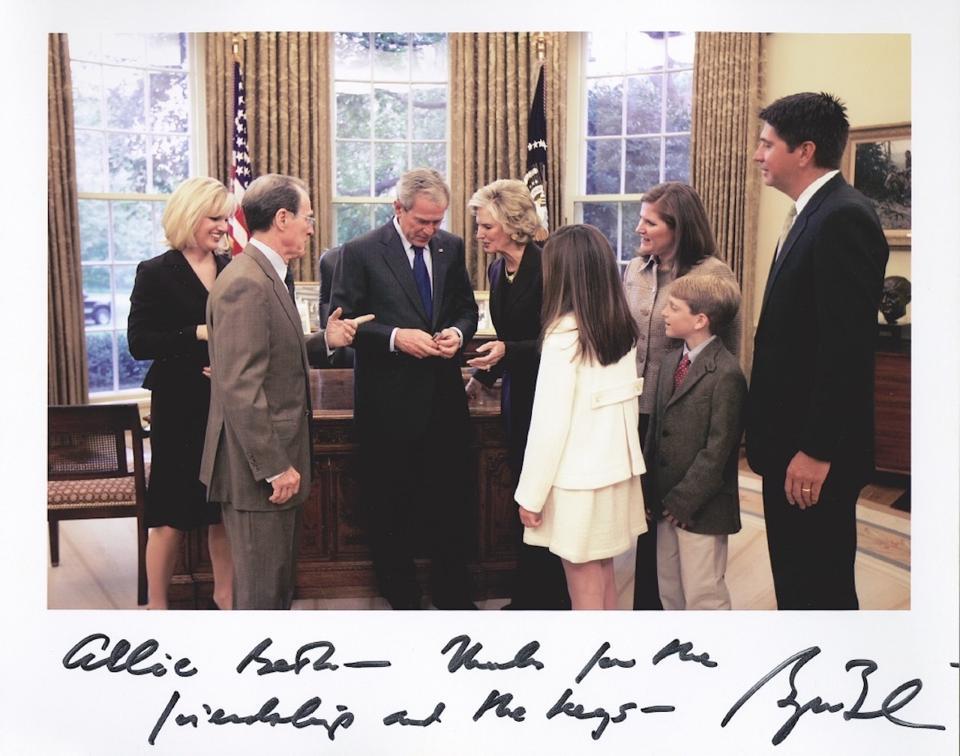 Allie Beth Allman hands President George Bush the keys to his new Dallas home