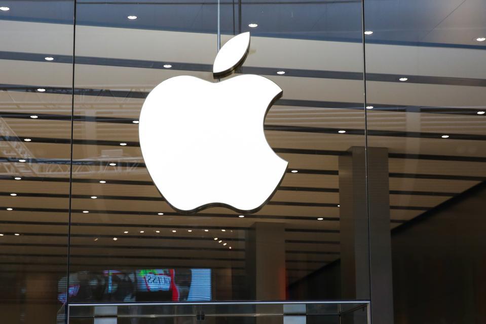 Apple's logo on its store window in London, UK...