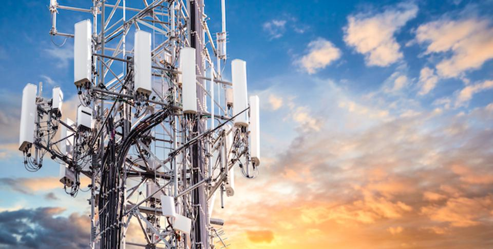 photo of a 5G Sunset Cell Tower: Cellular communications tower for mobile phone and video data transmission