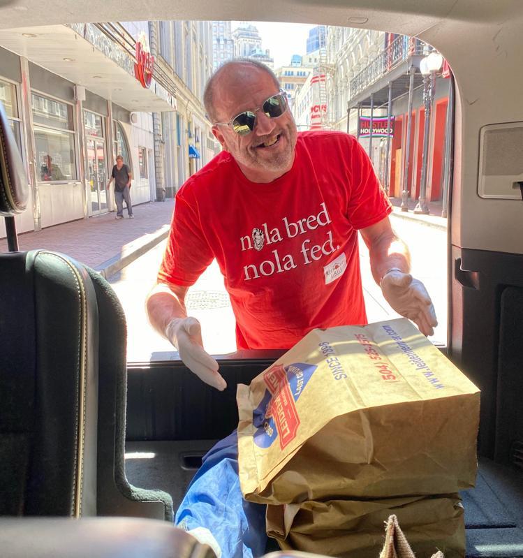 Ralph Brennan loads meals into a car