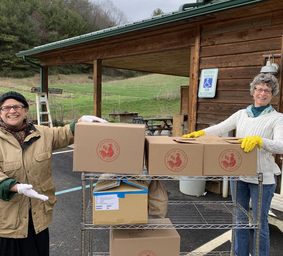 Red Rooster employees deliver meals