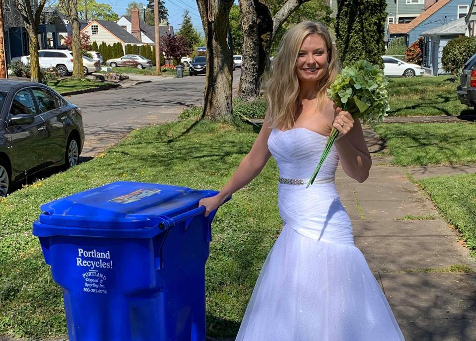 Aimee Renee in her wedding dress takes recycling