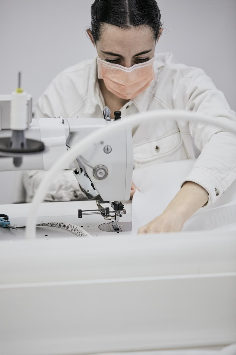 A hospital gown being made in the Louis Vuitton atelier