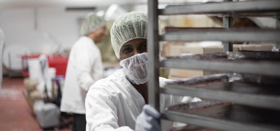 A Rhino employee pushes a cart of cookie dough