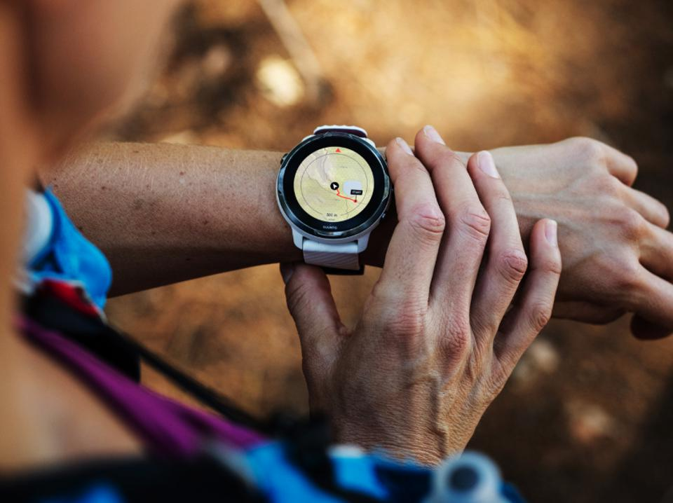 A close-up of a mom wearing the new Suunto 7