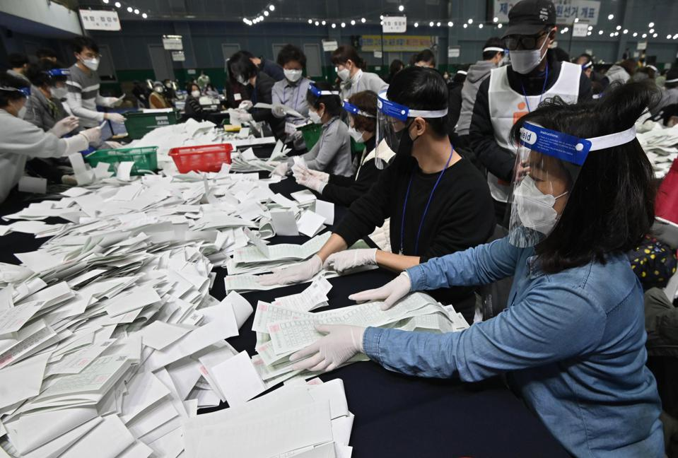 South Korean election officials sort voting papers