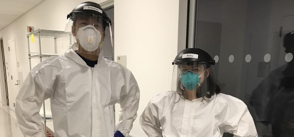 Enrique Lin Shiao (left) in personal protective equipment in Berkley, California.