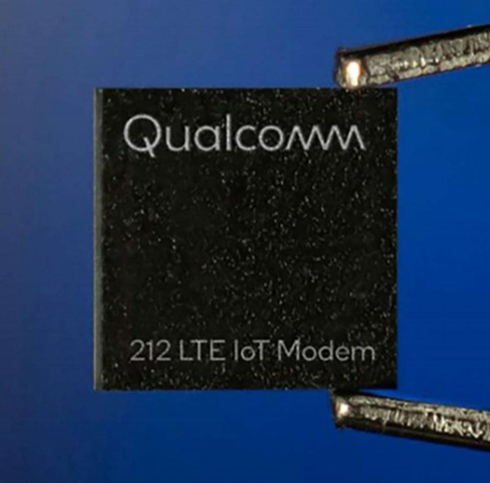 Image of the new 212 LTE modem chip held by tweezers