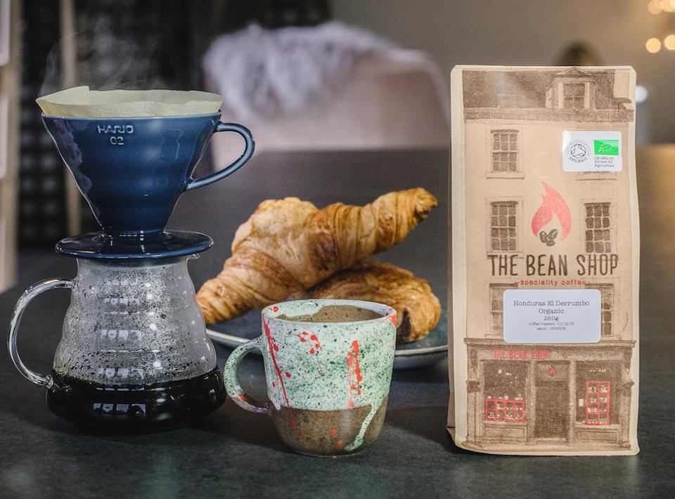 coffee cup, croissants and coffee beans