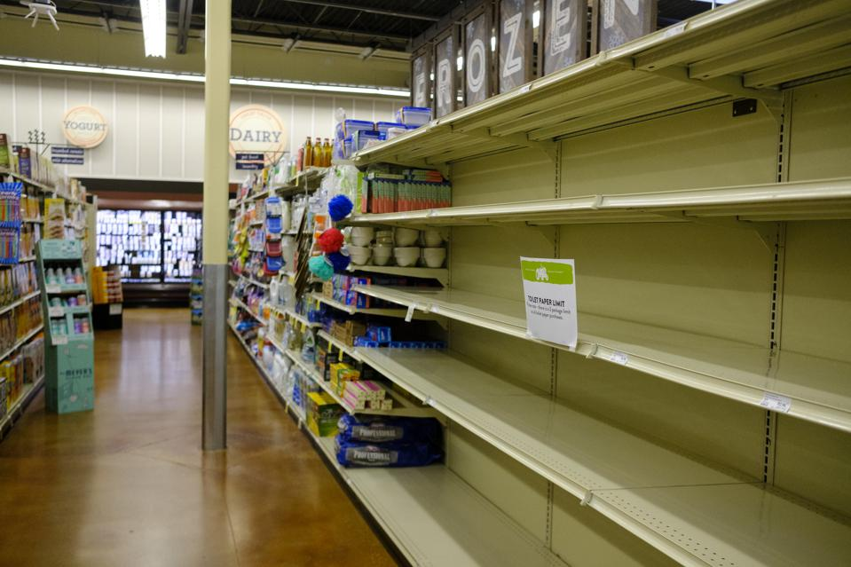 The shelves of a Fresh Thyme market are emptied of toilet...
