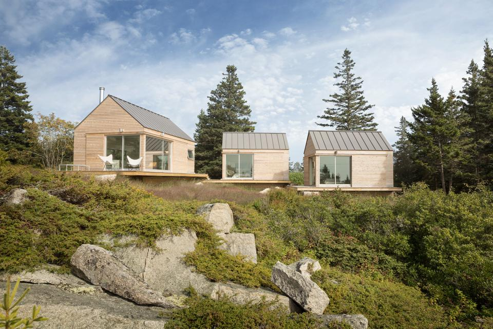 These Little Houses on a Ferry in Vinalhaven, ME were designed by GoLogic, engineered by Bensonwood with panels provided by Chantiers Chibougamau, a factory in Quebec.