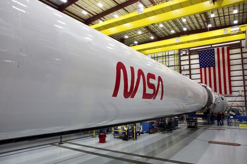The DM-2 Falcon 9 Booster shows NASA's 'Worm' Logo