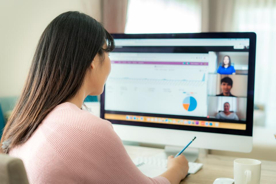 Woman participating in a video conference where data is shared.