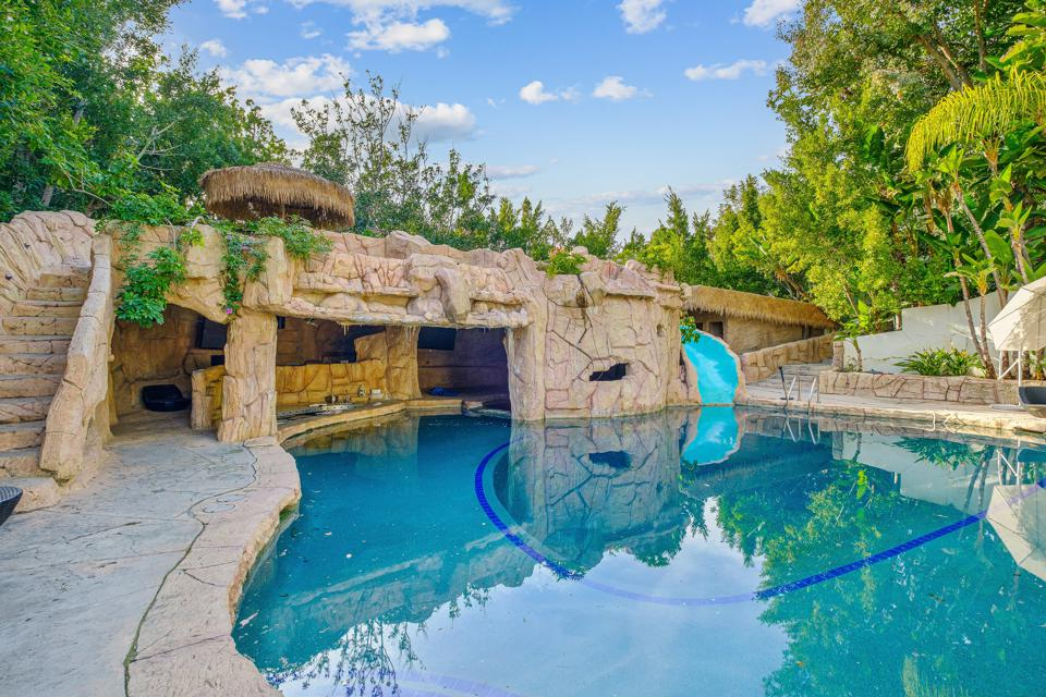 Swimming pool with stone grotto