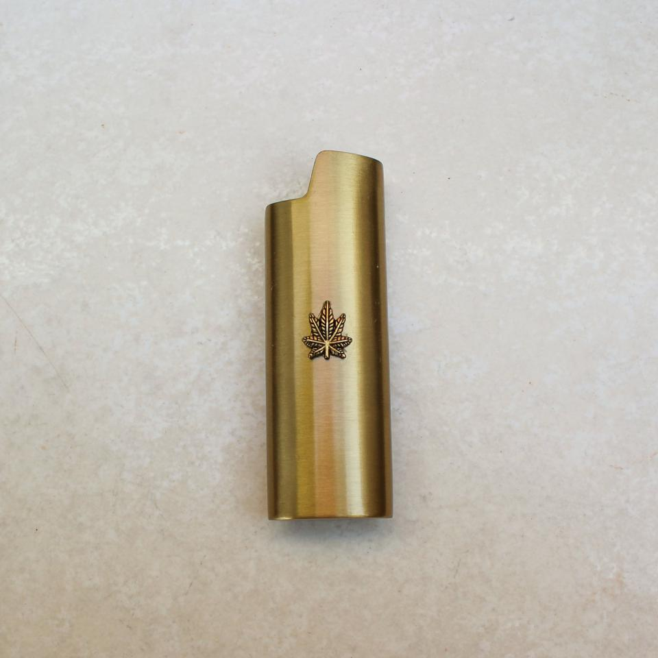 one gold lighter with a cannabis leaf
