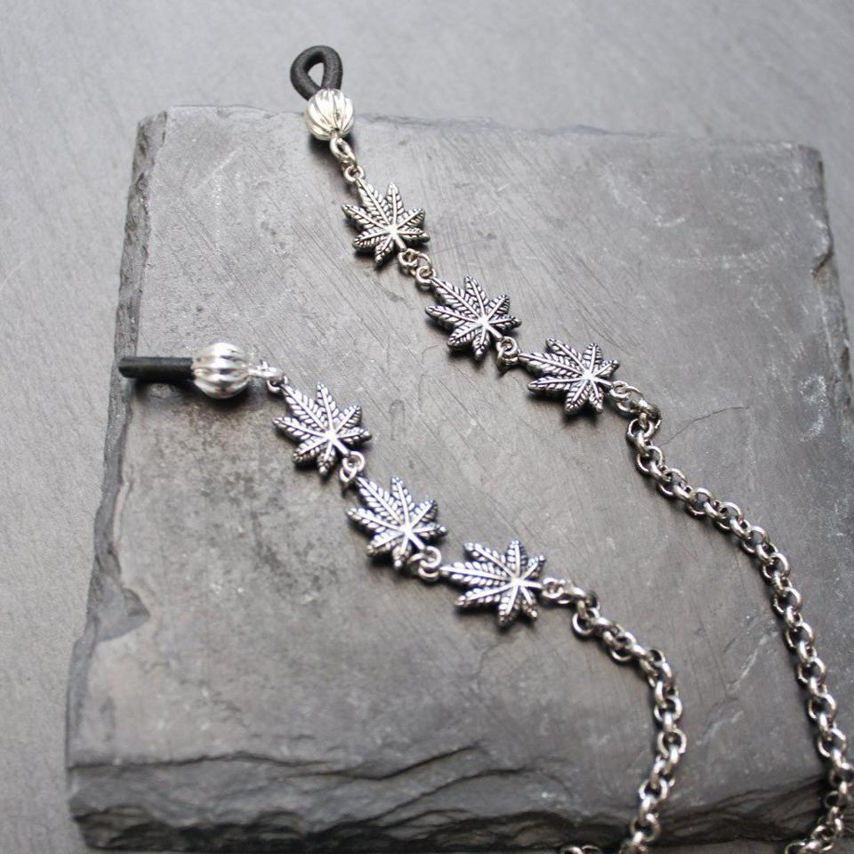 silver eyeglasses chain with cannabis leaves