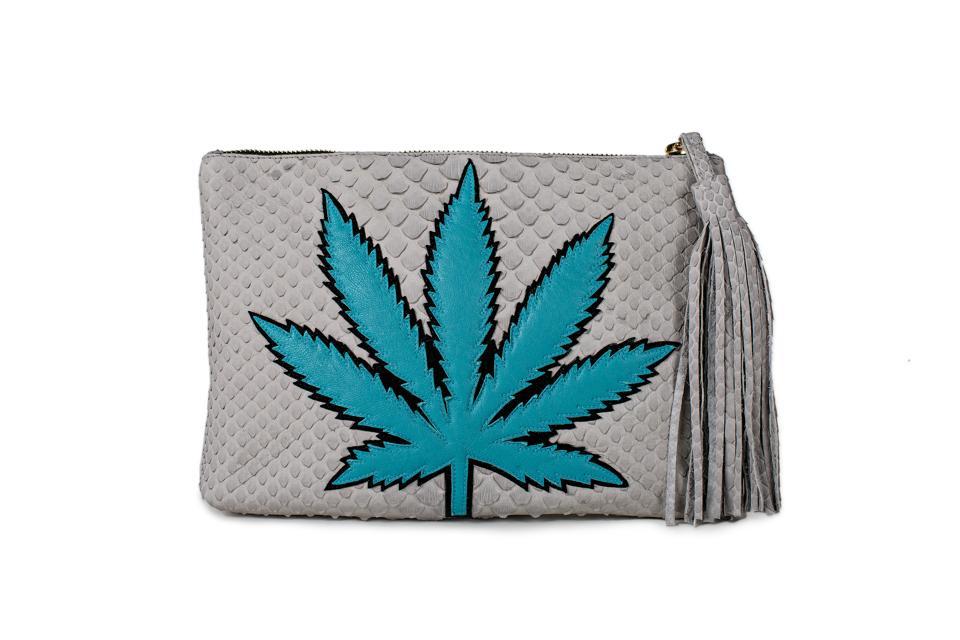 white tassel clutch with cannabis leaf