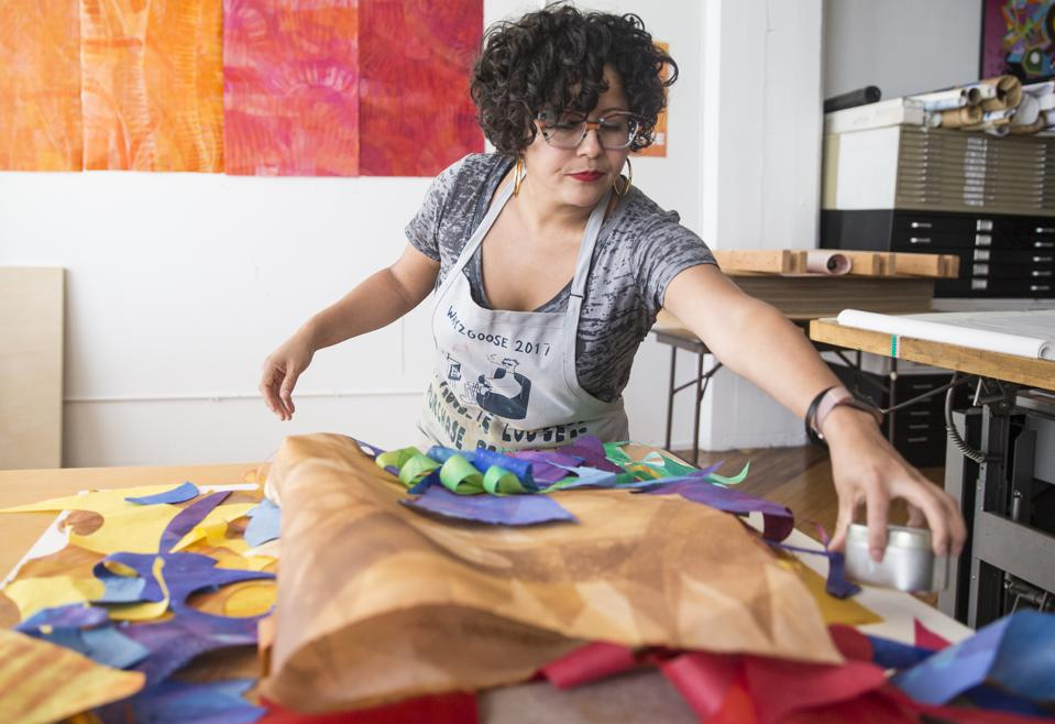 Favianna Rodriguez at work in her studio.