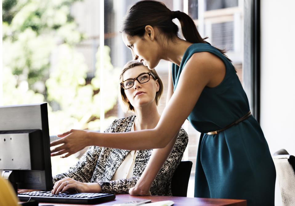 Businesswomen working at computer desk in office