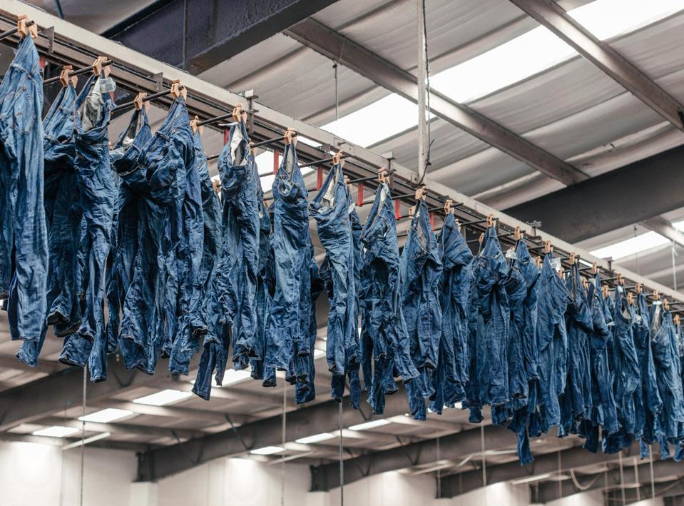 Everlane jeans hanging in factory Saitex in Vietnam