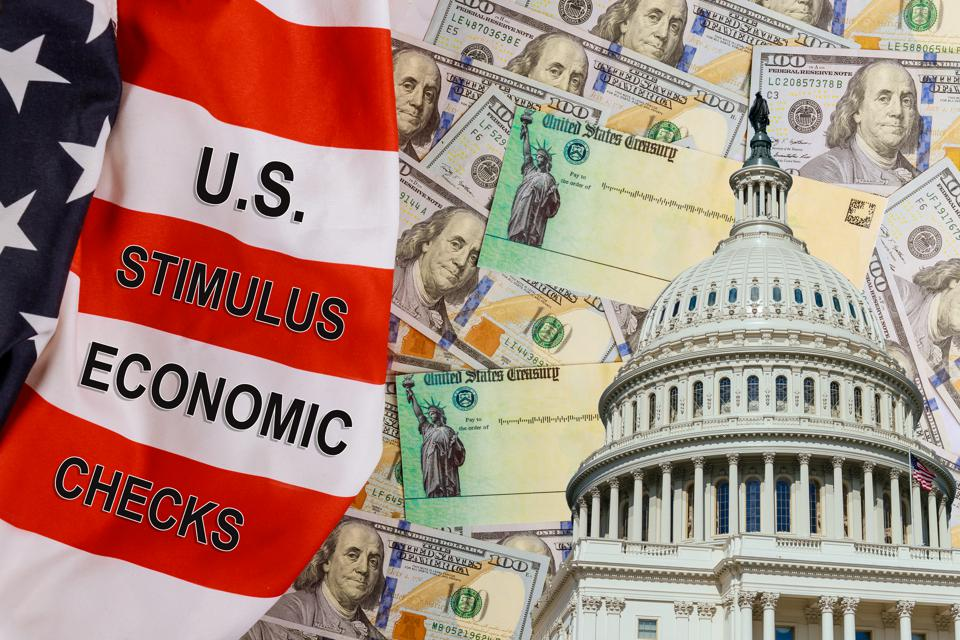 U.S. Economic STIMULUS CHECKS Bill Coronavirus financial relief checks from government USA dollar cash banknote on American flag Global pandemic Covid 19 lockdown