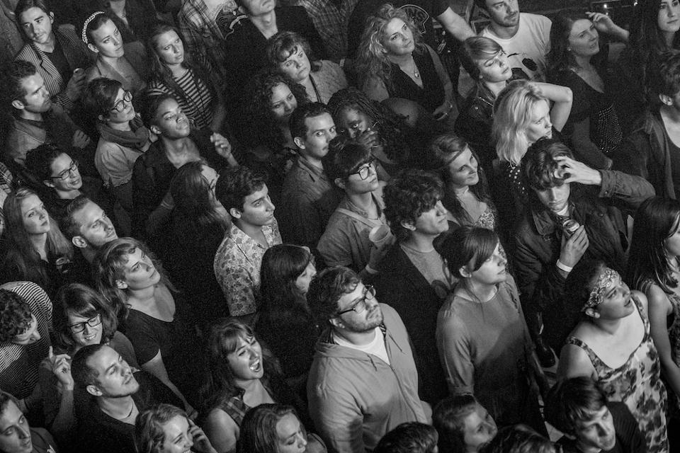A black and white image of a crowd watching a Grimes concert in 2012.