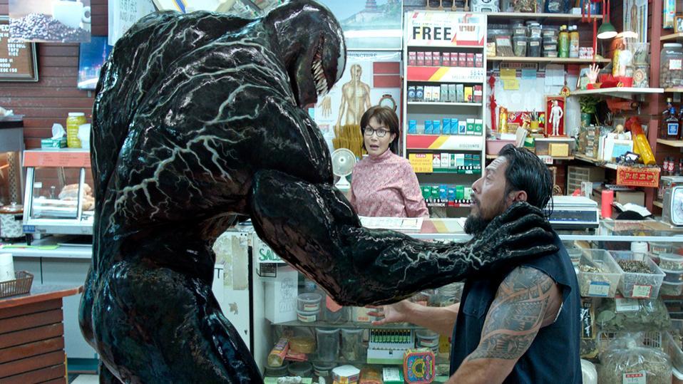 Tom Hardy bites a man's head clean off in 'Venom.'