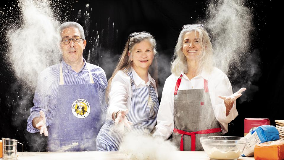 Ralph Carlton (left) and Karen Colberg (right) the co-CEOs of King Arthur, America's oldest flour business. They are joined by VP of Sustainability Suzanne McDowell (center).