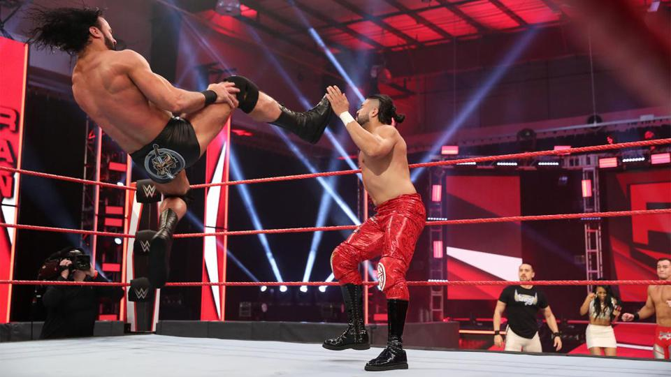 Drew McIntyre hits Andrade with a Claymore Kick on the 4/20/2020 edition of Raw.