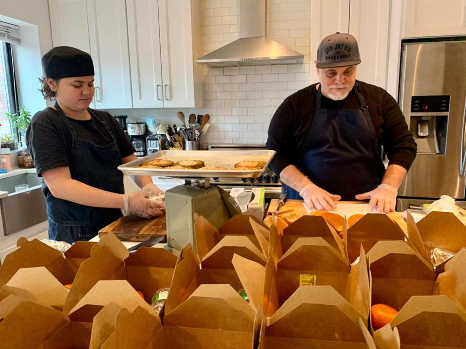 Felipe Avalos and 13-year-old son Valentino prepare vegan meals for hospital workers.