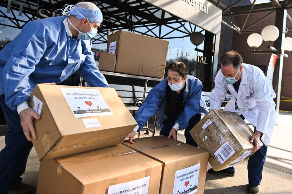 Healthcare Workers Unload Donated Masks at North Shore University Hospital in Oceanside, Long Island, New York