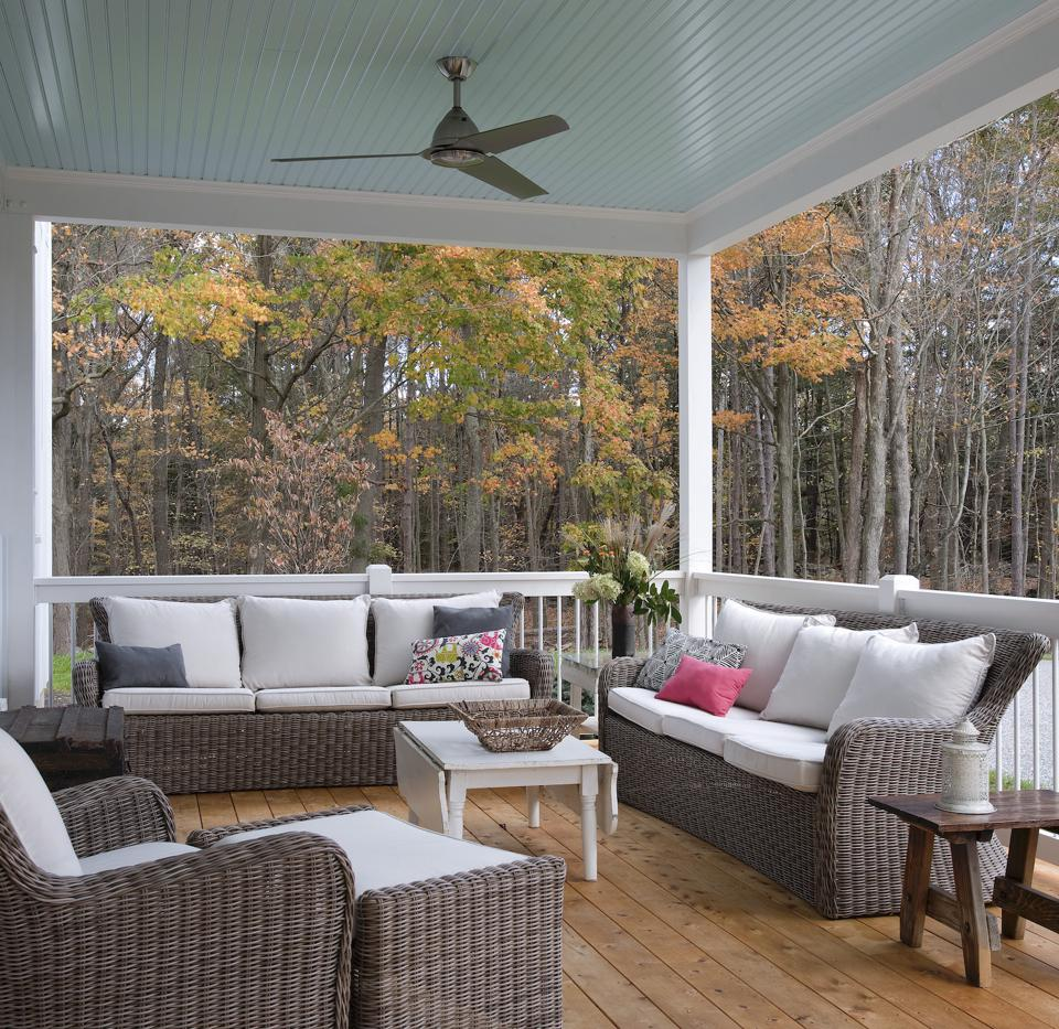This is a cozy outdoor space on this contemporary farmhouse designed and built by nth Homes.