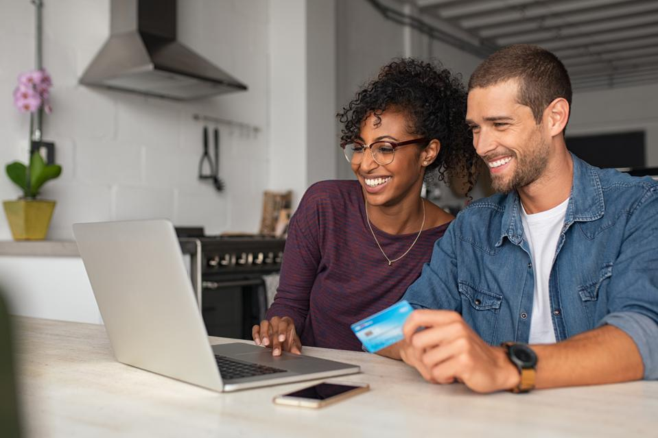 Happy multiethnic ouple making online payment