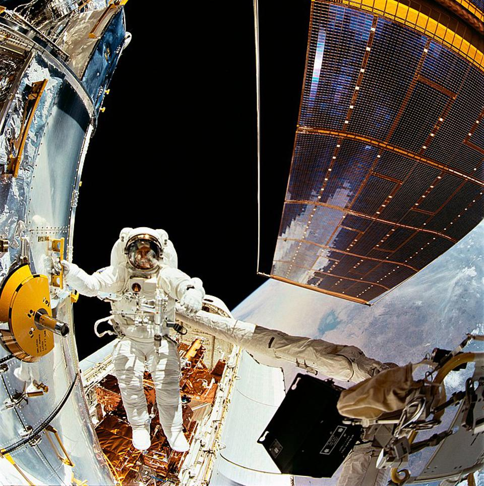 Astronaut Story Musgrave during first Hubble servicing spacewalk.