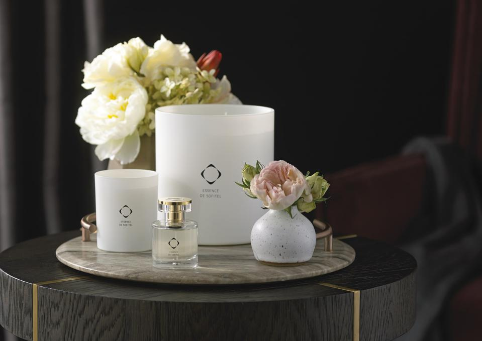 sofitel fragrance collection on table with flowers