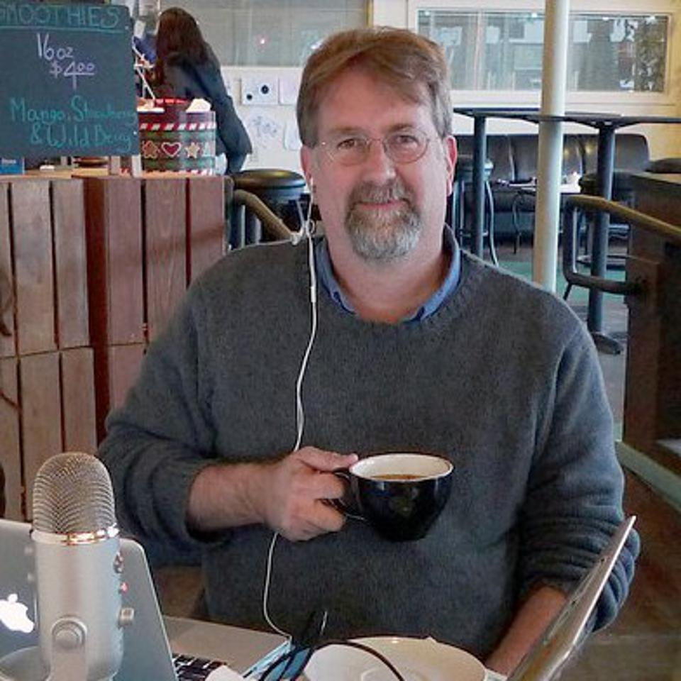 Chris Christensen from Amateur Traveler with his coffee and computer.