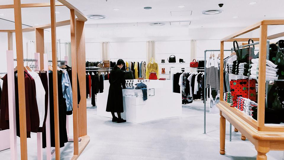 Woman in an empty store.