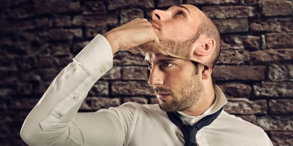 man removing mask