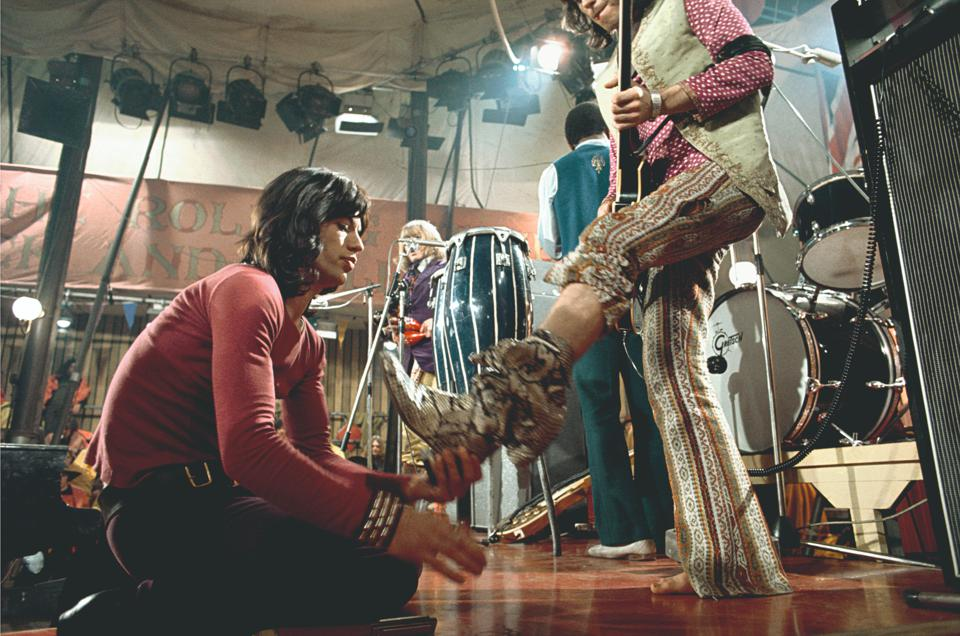 Mick Jagger (left) and Keith Richards (right) during filming of the Rolling Stones Rock and Roll Circus on December 11, 1968 (Photo by Bill Wyman appears in the new book Stones From the Inside: Rare and Unseen Images)
