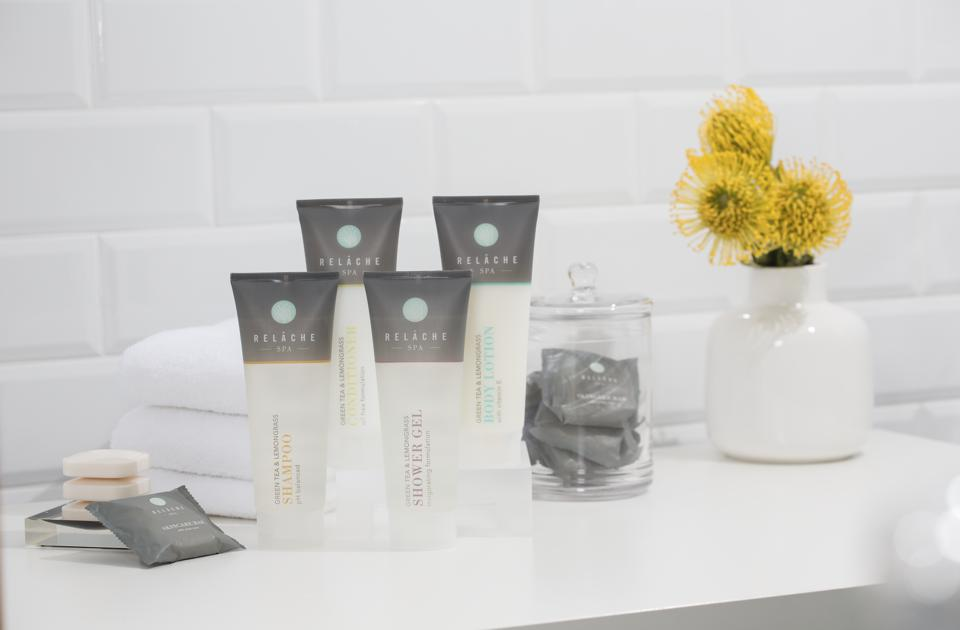 spa products on counter with yellow flowers