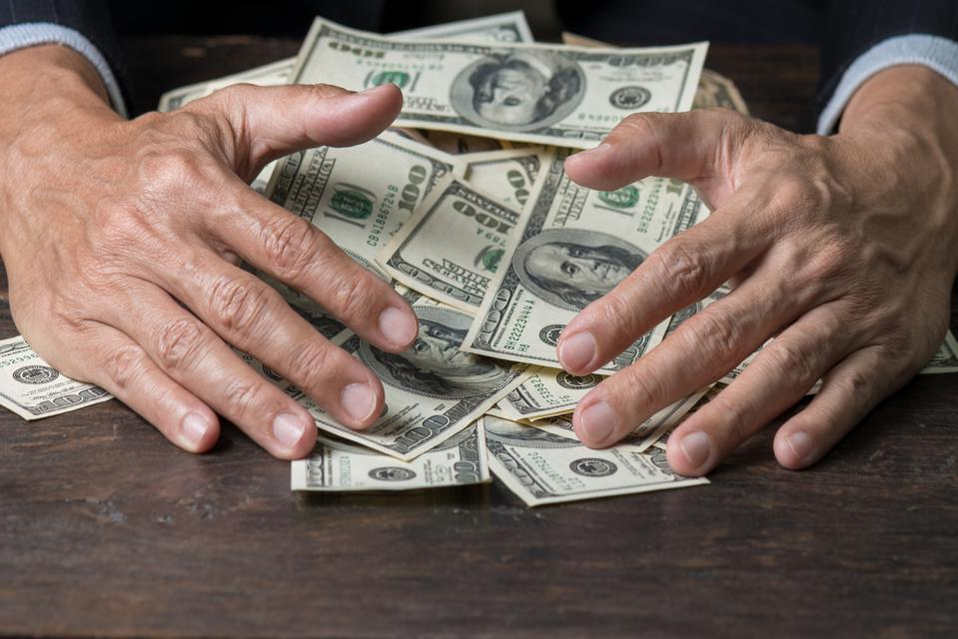 Man hands sweeping money,business concept.